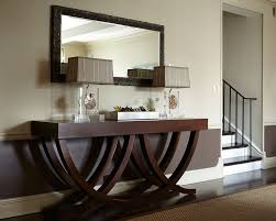 adorable dark wood console table with painting of decorating the