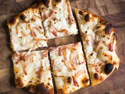alsace cuisine recipes tarte flambée alsatian pizza with fresh cheese onions and