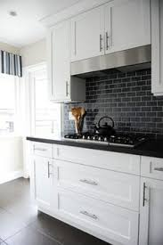 Black Countertop Kitchen by What We U0027re Loving Now Shiplap Walls Black Countertops White