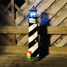 solar powered lighthouse garden light garden ornament next