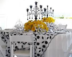 Black And White Centerpieces For Weddings by Black Candelabras With Yellow Daisies Around The Bottom Pretty