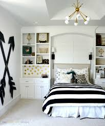Small Teenage Bedroom Decorated With Paisley Wallpaper And by Wooden Wall Arrows Wooden Walls Arrow And Pottery