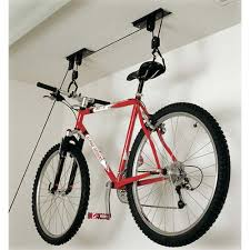 Bike Hanger Ceiling by Clear Up The Floor Space In Your Garage With The Hoist Monster