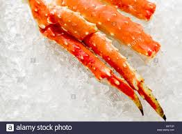 king crab legs on ice foodcollection stock photo royalty free