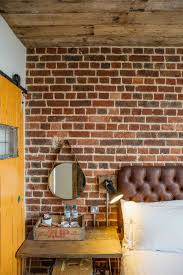factory style reclaimed wood clad ceiling exposed brick