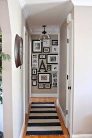 paint colors for hallway with no natural light new hallway light update wall stripes gallery wall and walls
