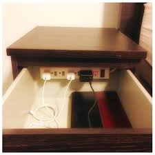 End Table Charging Station by Use A Power Strip In Bedside Table To Declutter Diy Craft Ideas