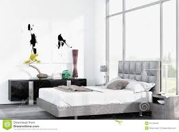 modern white king size bed against floor to ceiling window stock