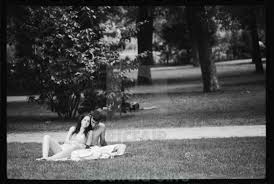 photojournalism young couple lovers in park black and white