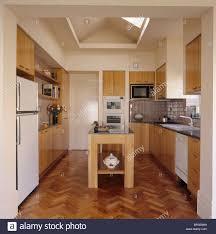 wood modern kitchen parquet flooring in modern kitchen extension with pale wood island