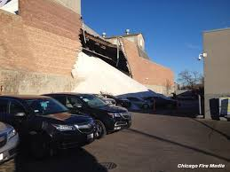 morton salt was piled too high causing wall to collapse cars to