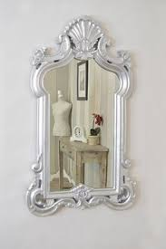 large boldly ornate wall mirror is the perfect statement piece for