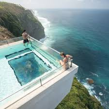 this infinity pool in bali is the wonderful places facebook image may contain ocean sky mountain outdoor water and nature