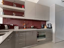 designer kitchen splashbacks mudgeeraba kitchen grey polyurethane cabinets burgundy glass