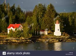 inside passage usa alaska lighthouse trees stock photo