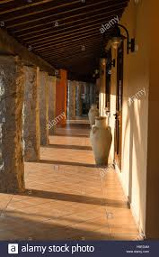 colonnade courtyard with columns and ornamental vase in
