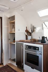steal this look a compact kitchen in a vintage airstream trailer