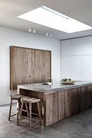 a rustic wooden kitchen island with sink and breakfast space with