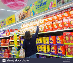 where to buy easter eggs morrisons supermarket uk woman buying easter eggs stock photo