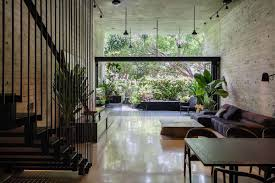 house with foliage and pool top winner at architectural award