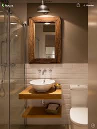 half whitees with contrast brown wall and small bathrooms bathroom