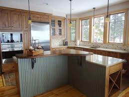 white kitchen wood island wood countertop white tile ceramic flooring mahogany wood island