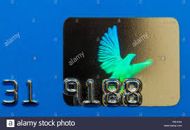 closeup macro photo of a flying dove hologram used on credit cards