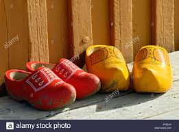stock photo of wooden shoes in front of a house in spitsbergen