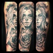 flower day of the dead on sleeve tattoos