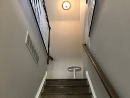 what is the best lighting for a sloped ceiling slanted ceiling top of stairwell light delimma