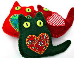 set of three colourful cat ornaments felt cats