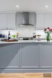 white shaker kitchen cabinets backsplash boston metrowest transitional kitchen grey island