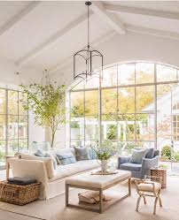 white plank ceilings large living room windows white shiplap