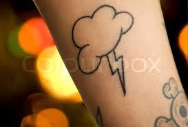 lightning and sky tattoo on human skin stock photo colourbox