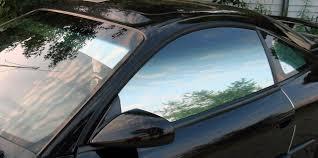 white lexus tinted windows reflective mirror like car window film tinting services