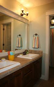 fascinating bathroom mirror ideas with brown wooden vanity and