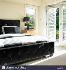 Leather Tufted Headboard Bedroom With Black Leather Tufted Headboard And French Doors To