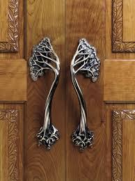 quirky tree like shape door handle designs in silver modern door