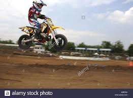 motocross races 6 year old races on a honda 50 cc motorcyle in motocross race