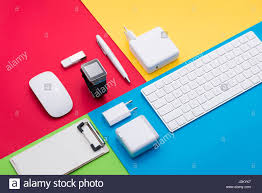 well organised white office objects on colorful background stock