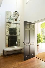 two story foyer with stacked mirrors over bench transitional