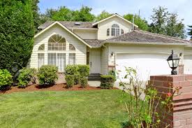 modern house exterior with garage front yard landscape with