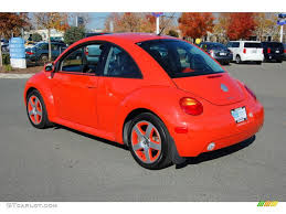 punch buggy car with eyelashes 2002 volkswagen new beetle special edition snap orange color