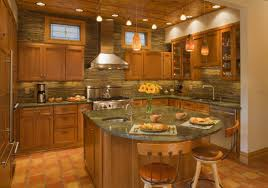 kitchen with an island also panel appliances with pendant lamps in