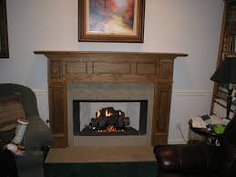 marble fireplace mantel combined with brown wooden mantel shelf
