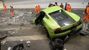 crashed lamborghini lamborghini ferrari crash in beijing sparks outrage online east
