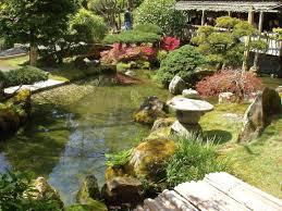Japanese Garden Lamp by Japanese Garden Designer With Garden Lamp And Koi Pond