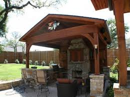 stone fireplace with enchanting outdoor patio cover designs and