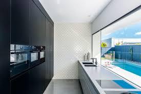 indoor outdoor kitchen designs 5 inspiring outdoor kitchen designs we love completehome