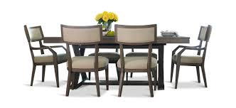 highline trestle table with 4 klismo side chairs and 2 klismo arm